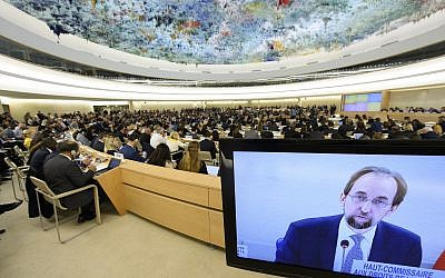 Zeid Ra'ad Al Hussein, UN high commissioner for human rights, is pictured on a TV screen during the opening of the 36th session of the Human Rights Council in Geneva on September 11, 2017. (Laurent Gillieron/ Keystone via AP)