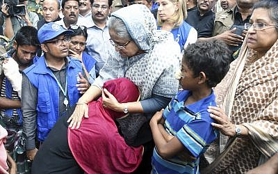 Bangladeshi Prime Minister Sheikh Hasina, center, meets with Rohingya Muslims at Kutupalong refugee camp, near the border town of Ukhia, Bangladesh, Tuesday, Sept. 12, 2017. (AP Photo/Saiful Kallol)