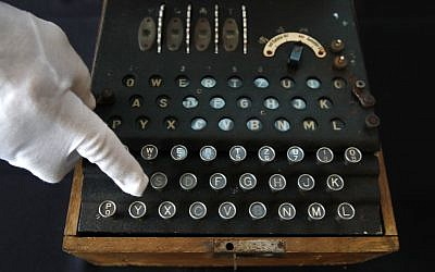 H. Keith Melton points to a key on an Enigma Machine with four rotors and a some Japanese characters that was used in World War II to encode messages, September 13, 2017, in Washington. (AP Photo/Jacquelyn Martin)