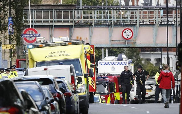 Ambulances and police are seen at the at Parsons Green subway station in London after a bombing on the London Underground on September 15, 2017. (AP Photo/Frank Augstein)