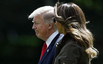 President Donald Trump and first lady Melania Trump walk from the Oval Office of the White House in Washington, Friday, Sept. 15, 2017, to Marine One for the short trip to Andrews Air Force Base, Md.. (AP/Carolyn Kaster)