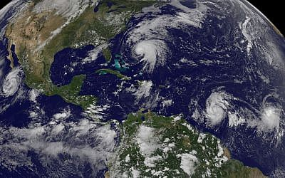 Tropical weather systems Hurricane Norma, left, on the Pacific Ocean side of Mexico; Jose, center, east of Florida; Tropical Depression 15, second from right, north of South America, and Tropical Storm Lee, right, north of eastern Brazil, on September 16, 2017. (NOAA-NASA GOES Project via AP)