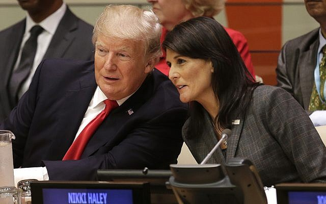 US President Donald Trump speaks with US Ambassador to the UN Nikki Haley, before a meeting at the UN General Assembly at UN headquarters in New York City, on September 18, 2017. (AP Photo/Seth Wenig)