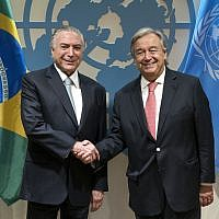 Brazilian President Michel Temer, left, is greeted by United Nations Secretary-General Antonio Guterres before a meeting Tuesday, Sept. 19, 2017, at UN headquarters. (AP Photo/Craig Ruttle)