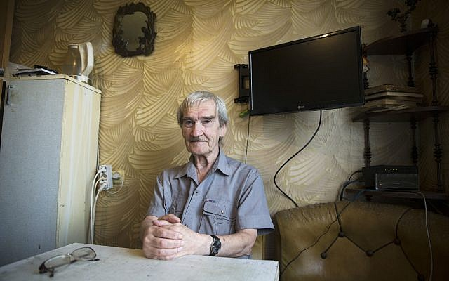 Former Soviet missile defense forces officer Stanislav Petrov poses, at his home in Fryazino, Moscow region, Russia, on August 27, 2015. (AP Photo/Pavel Golovkin/File)