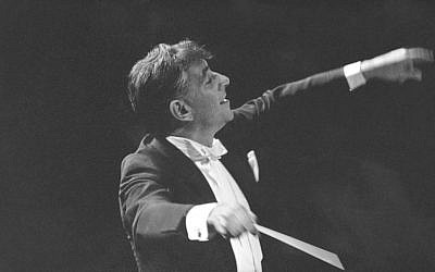 In this Sept. 24, 1962 file photo Leonard Bernstein leads the New York Philharmonic Orchestra in the inaugural concert in New York's new Philharmonic Hall.   (AP Photo, File)