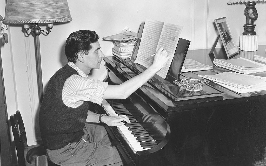 In this Feb. 24, 1945 file photo American-born conductor, composer, and pianist Leonard Bernstein works on a new musical score in his West side apartment in New York City. (AP Photo, File)