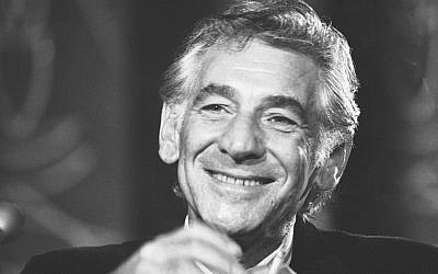 "In this July 26, 1971 file photo conductor Leonard Bernstein tells reporters in Washington that the work he is preparing for the 1971 opening of the John F. Kennedy Center for the Performing Arts is a ""labor of love.""  (AP Photo/Charles Harrity, File)"
