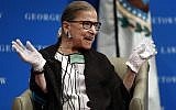 US Supreme Court Justice Ruth Bader Ginsburg reacts to applause as she is introduced by William Treanor, Dean and Executive Vice President of Georgetown University Law Center, at the Georgetown University Law Center campus in Washington, Wednesday, Sept. 20, 2017. (AP Photo/Carolyn Kaster)