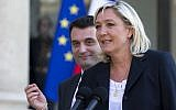 In this May 16, 2014 file photo, French far-right Front National Party President Marine Le Pen and vice-president Florian Philippot, left, talk to the media at the Elysee Palace, in Paris, France. (AP Photo/Jacques Brinon, File)