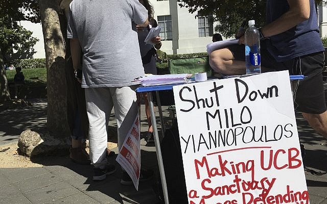 "Flyers and a booth on Sproul Plaza calling for protesters to ""Shut Down Milo Yiannopoulos,"" at the University of California, Berkeley campus in Berkeley, California, on September 21, 2017. (AP/Jocelyn Gecker)"