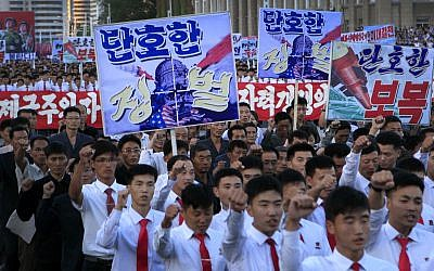 Hundreds of thousands of North Koreans gathered at Kim Il Sung Square to attend a mass rally against America on September 23, 2017, in Pyongyang, North Korea, a day after the country's leader issued a rare statement attacking Donald Trump. (AP Photo/Jon Chol Jin)