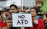 People take part in a demonstration of various left wing groups against German right wing party AfD (Alternative for Germany) in Berlin, Germany, September 23, 2017. (AP Photo/Michael Probst)