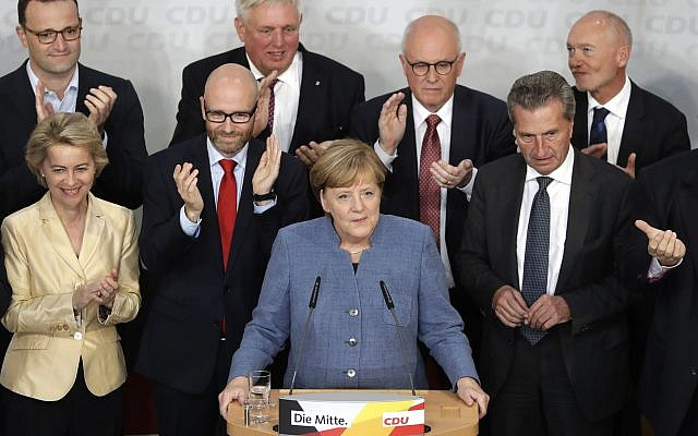 German Chancellor Angela Merkel is surrounded by party board members as she delivers a speech, after the German parliament elections at the headquarters of the Christian Democratic Union CDU in Berlin, Germany, September 24, 2017. (AP Photo/Matthias Schrader)