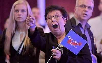 Guests at an Alternative for Germany party, AfD election party react to the first projections for the German election in Erfurt, Germany, September 24, 2017. (Martin Schutt/dpa via AP)