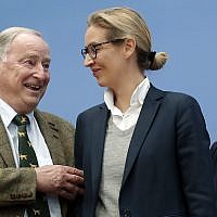 Frauke Petry, co-chairwoman of the AfD, right, stands with top candidates Alexander Gauland, left, and Alice Weidel, center, prior to a press conference of the Alternative for Germany, AfD, in Berlin, Germany, Monday, Sept. 25, 2017, the day after the nationalist party was elected first time into the German parliament. (AP Photo/Michael Sohn)