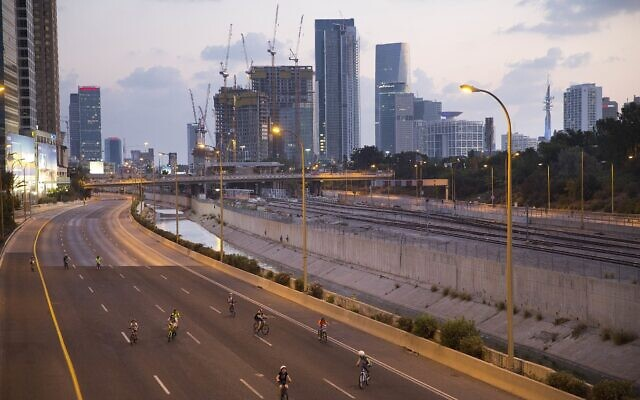 Israelis ride their bicycles on a car-free highway on Yom Kippur in Tel Aviv, Friday, Sept 29. 2017. (AP Photo/Oded Balilty)