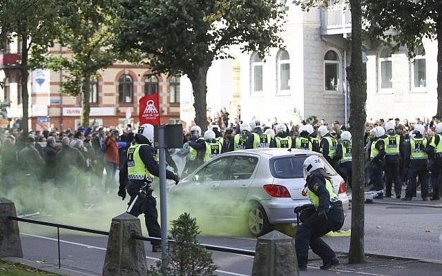 Police officers control counter-demonstrators ahead of a demonstration from the Nordic Resistance Movement in central Goteborg, Sweden, Saturday Sept. 30, 2017. (Adam Ihse/TT via AP)