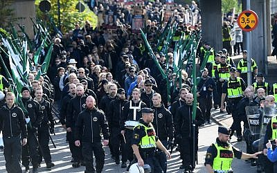 Members of the Nordic Resistance Movement march in central Gothenburg, Sweden, Saturday Sept. 30, 2017. (Fredrik Sandberg/TT via AP)