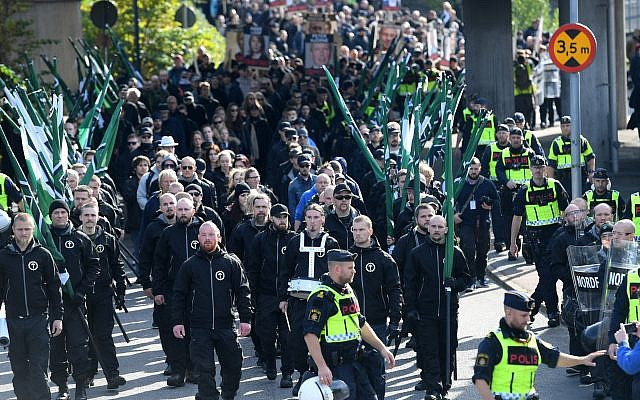 Members of the Nordic Resistance Movement march in central Gothenburg, Sweden, September 30, 2017. (Fredrik Sandberg/TT via AP)