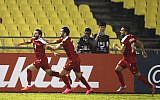 Syria's Mahmoud Almawas, left, celebrates scoring against China during the Group A World Cup qualifying soccer match in Melaka, Malaysia, Tuesday, June 13, 2017. (AP Photo/Vincent Thian)