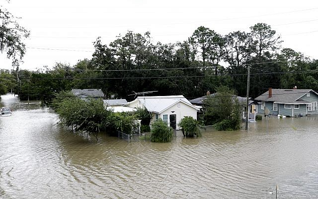 Water rises in a neighborhood after Hurricane Irma brought floodwaters to Jacksonville, Fla., Monday, Sept. 11, 2017. (AP Photo/John Raoux)