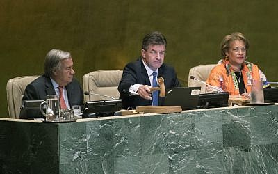 United Nations General Assembly President Miroslav Lajcak, center, is joined by Secretary-General Antonio Guterres, left, as he the opens the 72nd regular session of the UN General Assembly Tuesday, Sept. 12, 2017, at United Nations headquarters. (AP Photo/Mary Altaffer)