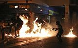 Protesters are engulfed in flames as they throw petrol bombs at police during an anti-fascist rally, commemorating the killing of Greek rap singer Pavlos Fyssas, in Athens, September 16, 2017. (AP Photo/Yorgos Karahalis)