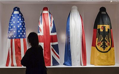 "A Visitor walks by an installation by Haitian artist Jean Ulrick Desert, titled The Burqa Project-On The Borders of My Dreams I Encountered My Double's Ghost for an exhibition ""Islam, It's Also Our History"" at the Espace Vanderborght in Brussels on Tuesday, Sept. 19, 2017. (Geert Vanden Wijngaert/AP)"
