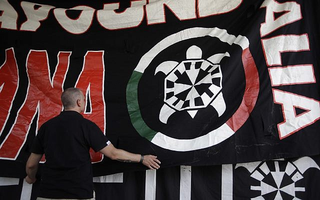 In this photo taken on September 9, 2017, a banner showing a turtle, the symbol of neo-fascist movement CasaPound, is hung at the group's national meeting in Borgo Sabotino, near Latina, Italy. (AP Photo/Alessandra Tarantino)