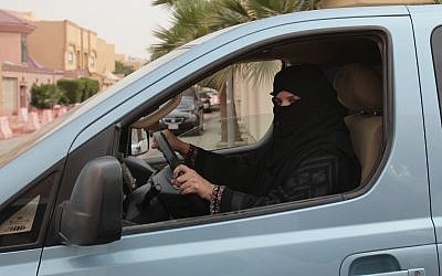 In this file photo from March 29, 2014, a  woman drives a car in Riyadh, Saudi Arabia, as part of a campaign to defy the country's ban on women driving. (AP Photo/Hasan Jamali, File)
