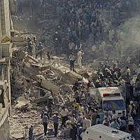 Firemen and rescue workers walk through the debris of Israel's Embassy after a terrorist attack in Buenos Aires, Argentina, March 17, 1992. (AP Photo/Don Rypka)