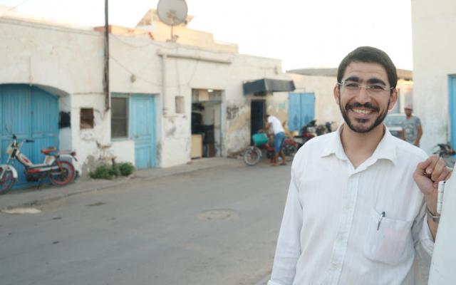 Ben Zion Dee'ie taking a break from Rosh Hashanah preparations in the Jewish town of Hara Kebira on the Tunisian island of Djerba, September 20, 2017. (Cnaan Liphshiz/JTA)
