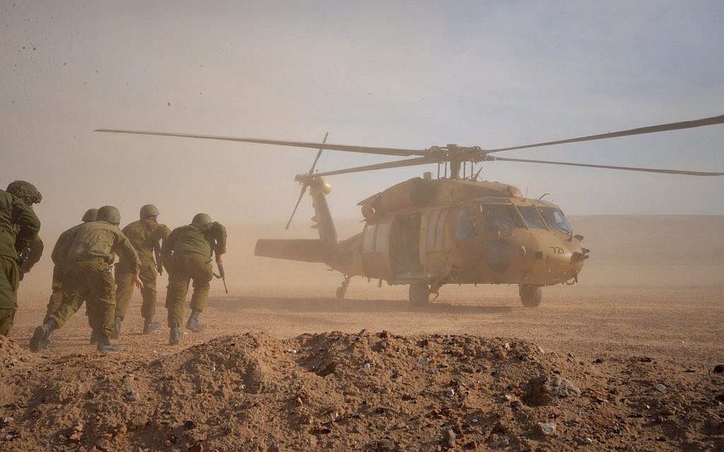 Soldiers run to a helicopter during an exercise in northern Israel simulating a war with the Hezbollah terrorist group in September 2017. (Israel Defense Forces)