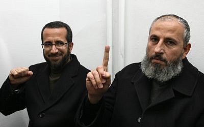 Hamas lawmaker Mohammed Totah (R) and Palestinian Authority minister for Jerusalem affairs Khaled Abu Arafeh (L), are seen at the Jerusalem District Court ahead of a hearing on February 15, 2012. (Kobi Gideon/Flash90)