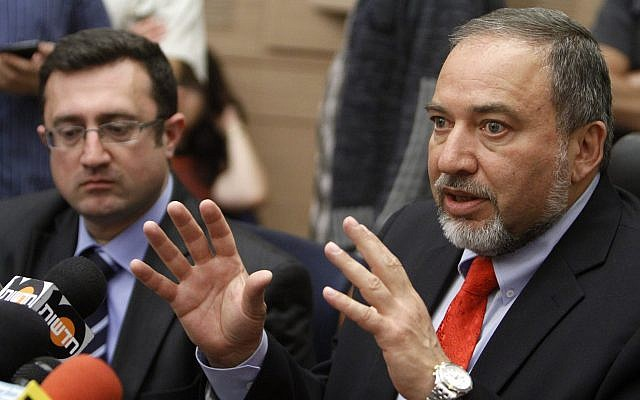 Yisrael Beytenu leader Avigdor Liberman (R) and MK Robert Ilatov (L) attend a party faction meeting at the Knesset on April 30, 2012. (Miriam Alster/Flash90/File)