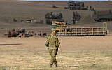 Illustrative image of a female IDF soldier seen in an army deployment area near Israel-Gaza border, on July 18, 2014. (Gili Yaari /FLASH90)