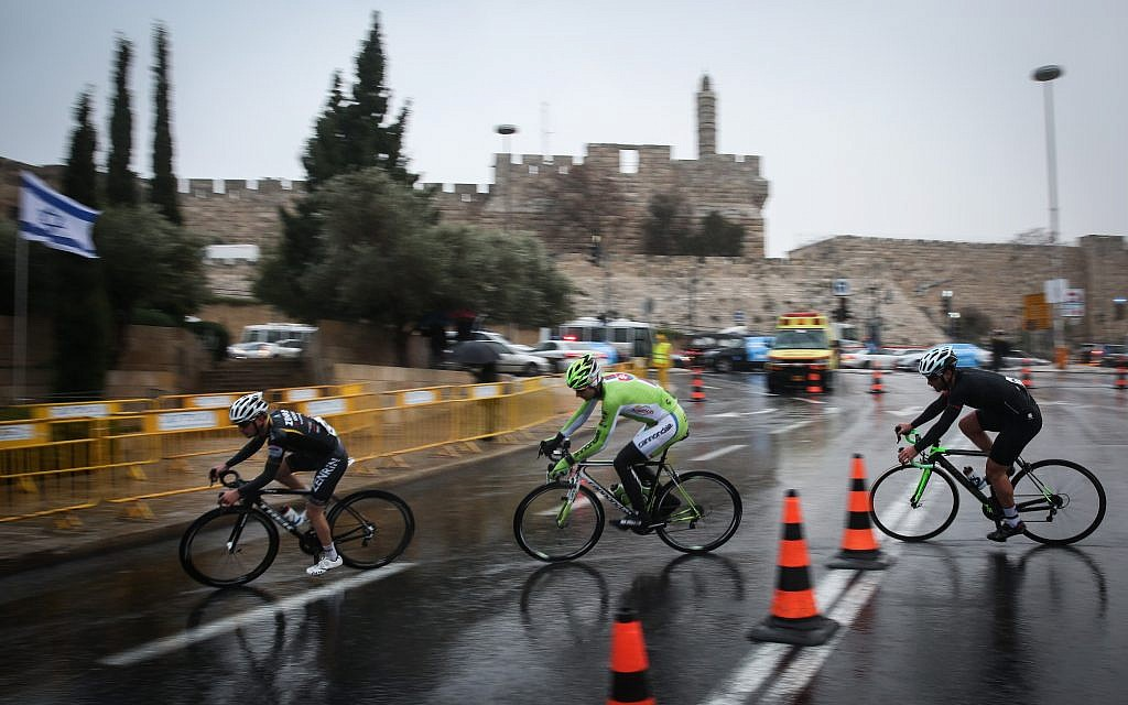 Professional cyclists ride near the Jaffa Gate to Jerusalem's Old City in a race organized by the Jerusalem Municipality, on November 26, 2014. (Hadas Parush/Flash90)