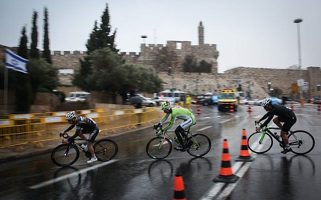 Professional cyclists ride near the Jaffa Gate to Jerusalem's Old City in a race organized by the Jerusalem Municipality, on November 26, 2014. (Hadas Parush/Flash90)