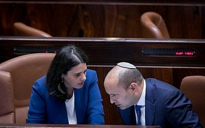 Jewish Home leader Naftali Bennett (R) with Jewish Home MK Ayelet Shaked in the Knesset plenum on November 16, 2016. (Yonatan Sindel/Flash90)