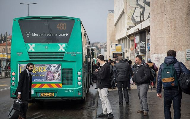 Illustrative: People wait for the bus outside Jerusalem's Central Bus Station on January 4, 2017. (Hadas Parush/Flash90)
