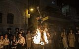 Ultra-Orthodox Jews burn an effigy of an IDF soldier during Lag B'Omer celebrations in the Mea Shearim neighborhood of Jerusalem on May 13, 2017. (Noam Revkin Fenton/Flash90)