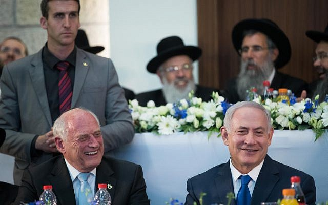 Executive Vice President of the Conference of Presidents of Major American Jewish Organizations, Malcolm Hoenlein (left), with Prime Minister Benjamin Netanyahu during the Jerusalem Day celebration at the Mercaz HaRav Yeshiva in Jerusalem, on May 24, 2017.  (Yonatan Sindel/Flash90)