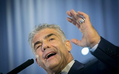 Yesh Atid party leader Yair Lapid attends a ceremony for new immigrants from North America at Ben Gurion airport in central Israel on August 15, 2017. (Miriam Alster/Flash90)