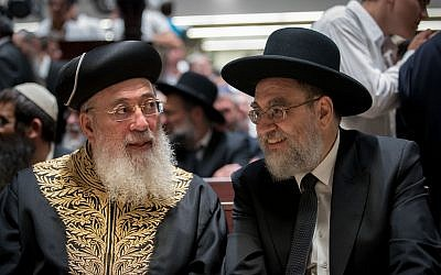 Rabbi Ariel Edery (r) and Chief Rabbi of Jerusalem Shlomo Amar attend the opening ceremony for the new building of Har Hamor Yeshiva in the neighborhood of Har Homa, Jerusalem, August 22, 2017. (Yonatan Sindel/Flash90)
