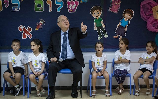 Illustrative: President Reuven Rivlin visits first grade students on the first day of school in Ma'ale Adumim, September 1, 2017. (Hadas Parush/Flash90)