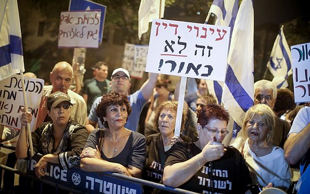 Illustrative: Residents of south Tel Aviv protest outside the home of then Supreme Court Justice Miriam Naor in Jerusalem on September 2, 2017 (Hadas Parush/Flahs90)