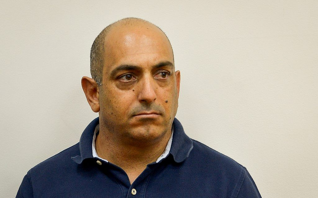 David Sharan is seen during a remand hearing at the Rishon Lezion Magistrate's Court, September 3, 2017. (Flash90)