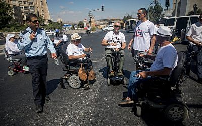 Disabled people and their supporters block the entrance to Jerusalem in protest of inadequate stipends, September 7, 2017. (Yonatan Sindel/Flash90)