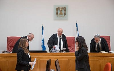 Supreme Court Justice Hanan Melcer (C) arrives at the High Court of Justice in Jerusalem for a hearing about public transportation on Shabbat, on September 11, 2017. (Yonatan Sindel/Flash90)